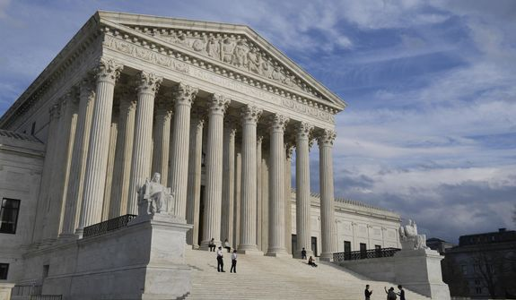 A March 15, 2019 view of the Supreme Court in Washington.  The Supreme Court decided Monday that one state cannot unwillingly be sued in the courts of another, overruling a 40-year precedent and perhaps, foreshadowing an argument over the viability of other high court decisions.  (AP Photo/Susan Walsh)