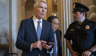 FILE - In an April 11, 2019 file photo, Sen. Rob Portman, R-Ohio, leaves the chamber as senators wrap up legislative work at the Capitol in Washington. Sen. Portman, whose re-election bid falls in the middle of President Donald Trump's would-be second term, is amassing millions of dollars toward his 2022 re-election bid.  (AP Photo/J. Scott Applewhite, File)