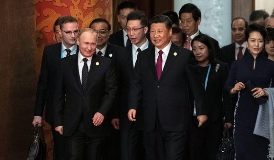 "In a think tank report, a senior fellow referred to the relationship between Russia and China as an ""emerging China-Russia Axis."" (Associated Press)"