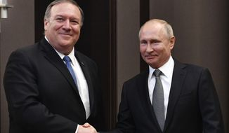 Russian President Vladimir Putin, right, and U.S. Secretary of State Mike Pompeo, pose for a photo prior to their talks in the Black Sea resort city of Sochi, southern Russia, Tuesday, May 14, 2019. Pompeo arrived in Russia for talks that are expected to focus on an array of issues including arms control and Iran. (Alexander Nemenov/Pool Photo via AP)