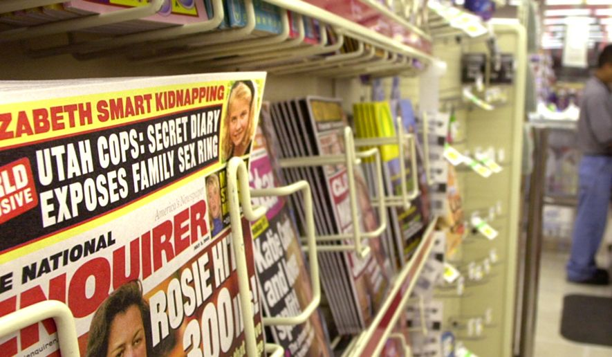 The National Enquirer, containing a story about the Elizabeth Smart abduction, is openly displayed on the racks at a Smith's grocery store Friday, June 21, 2002, in Salt Lake City. Because of the article, some stores in the chain are keeping the issue behind the counter. The neighborhood store near where the Smarts live isn't selling the issue at all. Elizabeth, 14, was kidnapped from her home June 5. (AP Photo/Douglas C. Pizac) ** FILE **