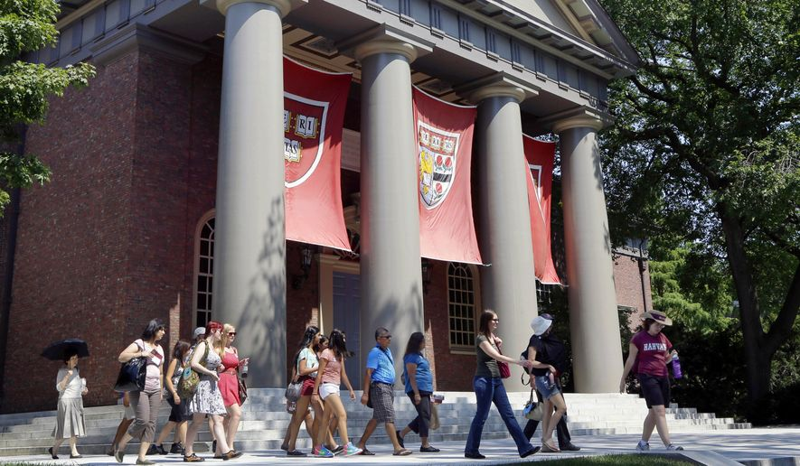 In this Aug. 30, 2012, file photo, a tour group walks through the campus of Harvard University in Cambridge, Mass. Word of an August 2017 Justice Department inquiry into how race factors into admissions at Harvard University has left top-tier colleges bracing for scrutiny of practices that have boosted diversity levels to new highs. While they keep their selection formulas under wraps, Ivy League colleges defend race-conscious approaches that contributed to a 17 percent increase in nonwhite students over a recent five-year span. (AP Photo/Elise Amendola, File)