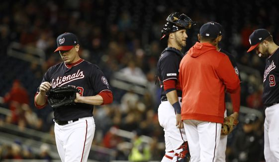 Washington Nationals starting pitcher Jeremy Hellickson, left, walks off the field after being relieved in the sixth inning of a baseball game against the New York Mets, Tuesday, May 14, 2019, in Washington. (AP Photo/Patrick Semansky)
