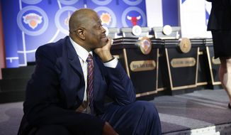 Former NBA player Patrick Ewing sits at the edge of the stage before the NBA basketball draft lottery Tuesday, May 14, 2019, in Chicago. (AP Photo/Nuccio DiNuzzo) **FILE**