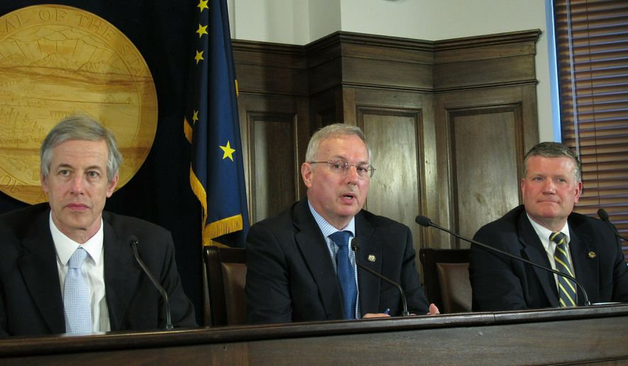 Alaska House Speaker Bryce Edgmon, center, speaks to reporters after the House failed to accept a Senate rewrite of a crime bill, Tuesday, May 14, 2019, in Juneau, Alaska. Also pictured are state Reps. Matt Claman, left, and Chuck Kopp. (AP Photo/Becky Bohrer)