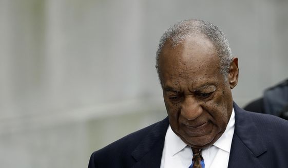 "In this Sept. 24, 2018, file photo, Bill Cosby departs after a sentencing hearing at the Montgomery County Courthouse in Norristown, Pa. The Pennsylvania judge who presided over Bill Cosby's sex-assault case says he let five other accusers testify at Cosby's retrial because they showed his actions were ""so distinctive"" they became ""a signature."" (AP Photo/Matt Slocum)"