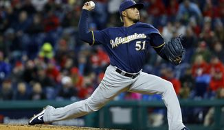 Milwaukee Brewers' Freddy Peralta pitches during the third inning of a baseball game against the Philadelphia Phillies, Monday, May 13, 2019, in Philadelphia. (AP Photo/Matt Slocum)
