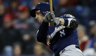 Milwaukee Brewers' Ryan Braun follows through after hitting a two-run home run off Philadelphia Phillies starting pitcher Jerad Eickhoff during the third inning of a baseball game, Tuesday, May 14, 2019, in Philadelphia. (AP Photo/Matt Slocum)
