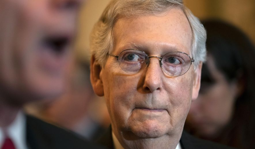 Senate Majority Leader Mitch McConnell, R-Ky., listens as Sen. John Barrasso, R-Wyo., speaks during a news conference at the Capitol in Washington, Tuesday, May 14, 2019. (AP Photo/J. Scott Applewhite)
