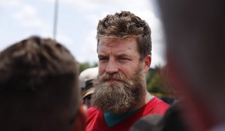Miami Dolphins quarterback Ryan Fitzpatrick (14) speaks to the media after NFL football practice on Tuesday, May 14, 2019, in Davie, Fla. (AP Photo/Brynn Anderson)