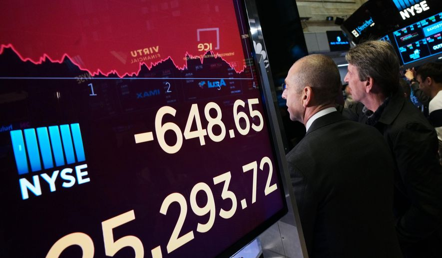 An electronic screen shows the drop in the Dow Industrials, Monday, May 13, 2019, at the New York Stock Exchange. U.S. stocks moved sharply lower Monday on Wall Street and extended the market's slide into a second week as investors seek shelter from an escalating trade war between the U.S. and China. (AP Photo/Mark Lennihan) ** FILE **