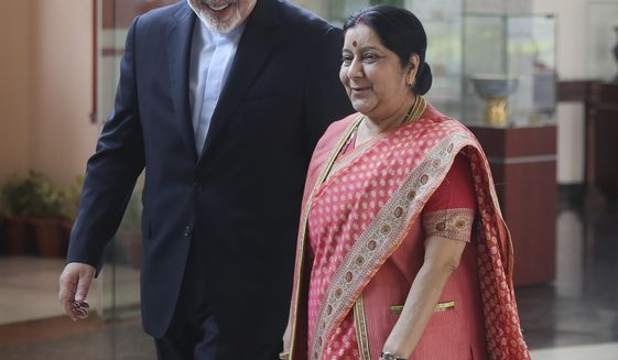 Iranian Foreign Minister Mohammad Javad Zarif, left, talks with his Indian counterpart Sushma Swaraj in New Delhi, India, Tuesday, May 14, 2019. Zarif's visit to New Delhi comes within days of the United States ending its waiver to India that allowed it to buy Iranian oil without facing American sanctions. (AP Photo/Manish Swarup)