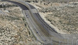 This Jan. 10, 2019, file photo shows a newly opened segregated West Bank highway near Jerusalem. (AP Photo/Mahmoud Illean, File)
