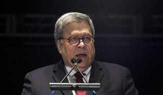 Attorney General William Barr speaks at the National Law Enforcement Officers Memorial Fund Annual Candlelight Vigil to commemorate new names added to the monument, during a ceremony at the National Mall in Washington, Monday May 13, 2019. (AP Photo/Jose Luis Magana)
