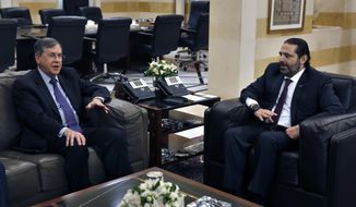 "U.S. Deputy Assistant Secretary of State David Satterfield, left, speaks during his meeting with Lebanese Prime Minister Saad Hariri, in Beirut, Lebanon, Tuesday, May 14, 2019. Satterfield's visit comes a week after President Michel Aoun presented the U.S. ambassador to Lebanon with a ""unified stance"" regarding the demarcation of maritime border between Lebanon and Israel. (AP Photo/Bilal Hussein)"