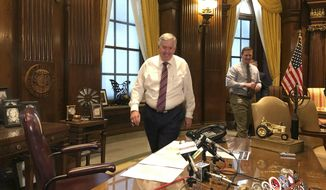 Missouri Gov. Mike Parson arrives for a news conference Tuesday, May 14, 2019, in his Capitol office in Jefferson City, Missouri. Parson said he wants an up-or-down vote in the Senate on legislation that authorizes up to $50 million of tax credits for General Motors, gives state officials the option of granting upfront incentives to other businesses and creates a new college scholarship for adults. Some Republican senators have blocked the chamber's work in opposition to the bill. (AP Photo/David A. Lieb)
