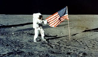 "FILE - In this November 1969 photo provided by NASA, Apollo 12 mission Commander Charles P. ""Pete"" Conrad stands on the moon's surface. He was the third man to walk on the moon. On Tuesday, May 14, 2019, NASA's chief says the Trump administration's proposed $1.6 billion budget boost is a ""good start"" for putting astronauts back on the moon. (AP Photo/NASA)"
