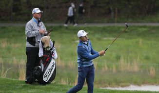 Jordan Spieth follows through on an approach shot on the fourth fairway during a practice round for the PGA Championship golf tournament, Tuesday, May 14, 2019, in Farmingdale, N.Y. (AP Photo/Julie Jacobson) **FILE**