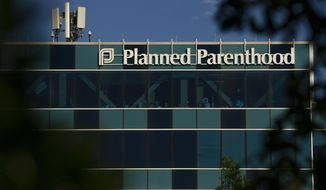 FILE - This April 19, 2019, file photo shows a Planned Parenthood building in Houston.  A federal appeals court is about to again take up the issue of whether and how states can cut off federal Medicaid funding for Planned Parenthood. Arguments are set for Tuesday, May 14. (Godofredo A Vasquez/Houston Chronicle via AP, File)