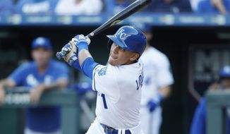 Kansas City Royals' Nicky Lopez watches his fly ball for an out in the first inning of a baseball game against the Texas Rangers at Kauffman Stadium in Kansas City, Mo., Tuesday, May 14, 2019. (AP Photo/Colin E. Braley)