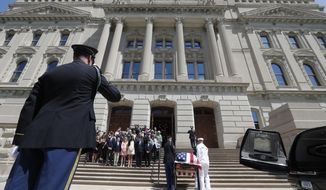 A military honor guard carries the casket of Sen. Richard Lugar into the Indiana Statehouse in Indianapolis, Tuesday, May 14, 2019. Lugar will lay in repose in the Statehouse rotunda until noon Wednesday, followed by his funeral. He died April 28 at age 87. (AP Photo/Michael Conroy)
