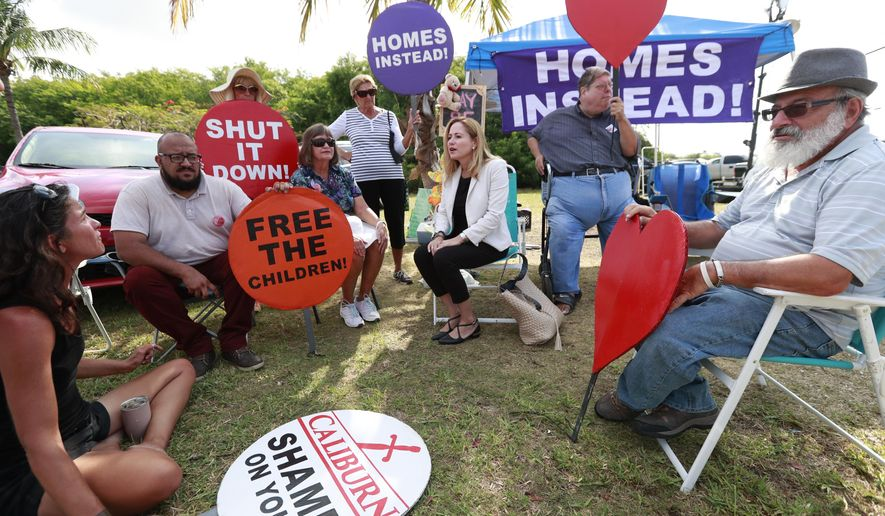 Representative Debbie Mucarsel-Powell, center, D-Fla., talks with demonstrators before attempting to enter the Homestead Temporary Shelter for Unaccompanied Children, Monday, May 6, 2019, in Homestead, Fla. Mucarsel-Powell was denied access to the shelter. (AP Photo/Wilfredo Lee)