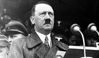 German Chancellor Adolf Hitler during his address to 80,000 workers in the Lustgarten, Berlin, May 1, 1936, s part of the May Day Celebrations. (AP Photo)