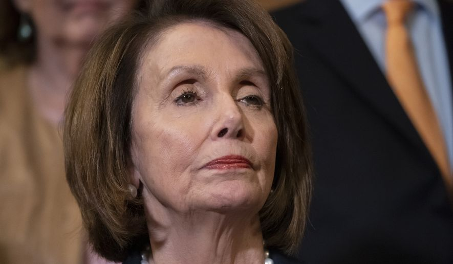 "House Speaker Nancy Pelosi, D-Calif., stands at a Democratic event ahead of a House floor vote on the Health Care and Prescription Drug Package, at the Capitol in Washington, Wednesday, May 15, 2019. Earlier, at the National Peace Officers Memorial Day service, Attorney General William Barr asked Pelosi, ""Madam Speaker, did you bring your handcuffs?"" a reference to Barr's refusal to comply with congressional subpoenas related to special counsel Robert Mueller's report. (AP Photo/J. Scott Applewhite)"