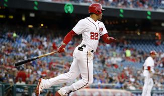 Washington Nationals' Juan Soto hits a sacrifice groundout in the first inning of a baseball game against the New York Mets, Wednesday, May 15, 2019, in Washington. Victor Robles scored on the play. (AP Photo/Patrick Semansky) ** FILE **
