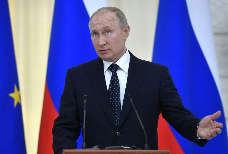Russian President Vladimir Putin gestures during his and Austrian President Alexander Van der Bellen's joint news conference in Moscow, Wednesday, May 15, 2019. (Alexander Nemenov/Pool Photo via AP)