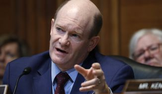 Financial Services and General Government subcommittee Ranking Member Sen. Chris Coons, D-Del., questions Treasury Secretary Steve Mnuchin during a Financial Services and General Government subcommittee hearing, Wednesday May 15, 2019, on Capitol Hill in Washington. (AP Photo/Jacquelyn Martin)
