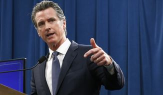 FILE - In this May 9, 2019 file photo Gov. Gavin Newsom discusses his revised 2019-2020 state budget during a news conference in Sacramento, Calif. The state Senate rejected Newsom's budget proposal Wednesday, May 15, 2019, that would put a tax on most residential water bills to improve drinking water in some of the state's poorest areas. Instead Senate leaders want to use $150 millions of existing tax dollars to pay for the improvements. (AP Photo/Rich Pedroncelli, File)