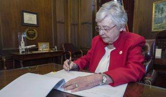 A spokeswoman for Alabama Gov. Kay Ivey said the bill is undergoing a legal review before the governor decides whether to sign it. (Associated Press)