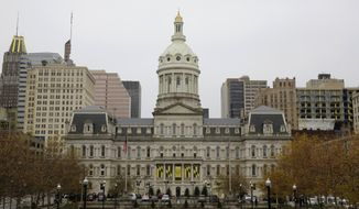 This Dec. 6, 2016, photo shows the City Hall building from the steps of the War Memorial Building in Baltimore. More than a week after a cyberattack hobbled Baltimore's computer network, city officials said Wednesday, May 15, 2019, they can't predict when its overall system will be up and running and continued to give only the broadest outlines of the problem. (AP Photo/Patrick Semansky)