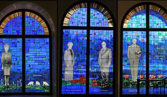 This Dec. 12, 2013 photo shows a composite of three different windows designed for the Southwestern Baptist Theological Seminary MacGorman Chapel in Fort Worth, Texas. The stained-glass windows honoring some religious leaders who helped shift the Southern Baptist Convention to a more conservative stance have been removed from a North Texas chapel. The Fort Worth Star-Telegram reported Wednesday, May 15, 2019 that the windows featured dismissed Southwestern Baptist Theological Seminary President Paige Patterson. He was fired last May amid criticism of his responses to rape allegations made years apart by two students. (Paul Moseley/Fort Worth Star-Telegram via AP)