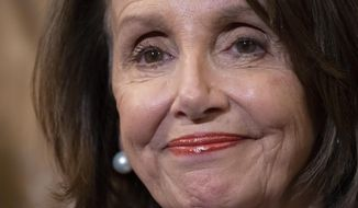 House Speaker Nancy Pelosi, D-Calif., stands at a Democratic event ahead of a House floor vote on the Health Care and Prescription Drug Package, at the Capitol in Washington, Wednesday, May 15, 2019.  (AP Photo/J. Scott Applewhite)