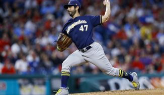 Milwaukee Brewers' Gio Gonzalez pitches during the third inning of the team's baseball game against the Philadelphia Phillies, Wednesday, May 15, 2019, in Philadelphia. (AP Photo/Matt Slocum)