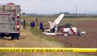 This photo from video provided by KCRA-TV shoes the wreckage of one of two crop dusters that collided in midair and crashed into fields in Yuba City, Calif., Wednesday, May 15, 2019. Both pilots were killed. The Sutter County Sheriff's Office says the single-engine Grumman Ag Cats were seeding the field at the time of Wednesday's collision. (KCRA-TV via AP)