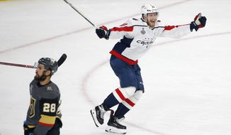 In this June 7, 2018, file photo, Washington Capitals center Lars Eller, right, celebrates his goal as Vegas Golden Knights left wing William Carrier skates away during the third period in Game 5 of the NHL hockey Stanley Cup Finals in Las Vegas. Paying the bills, going out to dinner and cutting the grass can fall by the wayside for NHL players on long playoff runs. With so much focus on hockey, everything on the outside is forgotten about this time of year. (AP Photo/Ross D. Franklin, File) **FILE**