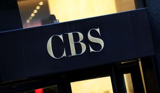 This Thursday, Dec. 6, 2018, file photo shows the CBS logo at the entrance to its headquarters, in New York.  (AP Photo/Mark Lennihan, File) **FILE**