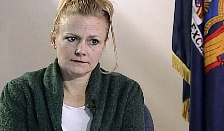 "FILE - In this 2010 file image from video courtesy of WMUR television of Manchester, N.H., Pamela Smart is shown during an interview at the corrections facility in Bedford Hills, N.Y. Smart is again asking for a chance at freedom after she was sentenced to life in prison without parole for recruiting her teenage lover William ""Billy"" Flynn to kill her husband Gregg Smart in 1990 in Derry, N.H. A council meets Wednesday, May 15, 2019, to consider her appeal for a hearing for parole consideration or reduced sentence. A similar request was denied nearly 14 years earlier. (WMUR Television via AP, File)"