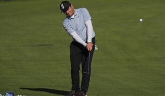 Francesco Molinari, of Italy, chips onto a practice green before a practice round for the PGA Championship golf tournament, Wednesday, May 15, 2019, at Bethpage Black in Farmingdale. (AP Photo/Julie Jacobson)
