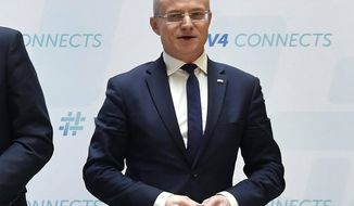 """FILE - In this Thursday, Feb. 22, 2018 file photo, Deputy Secretary of State for the Polish Ministry of Foreign Affairs Marek Magierowski poses for photographs ahead of the ministerial meeting of the Visegrad Group (V4) countries in Budapest, Hungary. Poland's prime minister on Wednesday May 15, 2019 condemned what he described as a """"xenophobic"""" attack on the country's ambassador to Israel, Marek Magierowski, on a Tel Aviv street. (Tibor Illyes/MTI via AP, File)"""