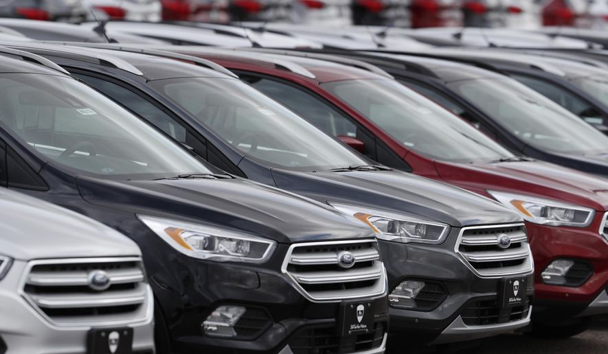 FILE- In this Feb. 17, 2019, file photo rows of unsold 2019 Escape sports-utility vehicles sit in long rows at a Ford dealership in Broomfield, Colo. On Wednesday, May 15, the Commerce Department releases U.S. retail sales data for April. (AP Photo/David Zalubowski, File)