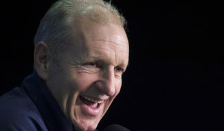 "FILE - In this Sept. 28, 2016, file photo, Europe coach Ralph Krueger speaks during a news conference at the World Cup of Hockey in Toronto. Krueger has officially been named the new coach of the Buffalo Sabres as the franchise seeks to return to the playoffs after an eight-year absence. The Sabres announced the hire on Wednesday, May 15, 2019. General manager Jason Botterill says in a statement that Krueger has adapted to ""a variety of high-pressure environments while leading some of the world's elite players. (Nathan Denette/The Canadian Press via AP, File)"