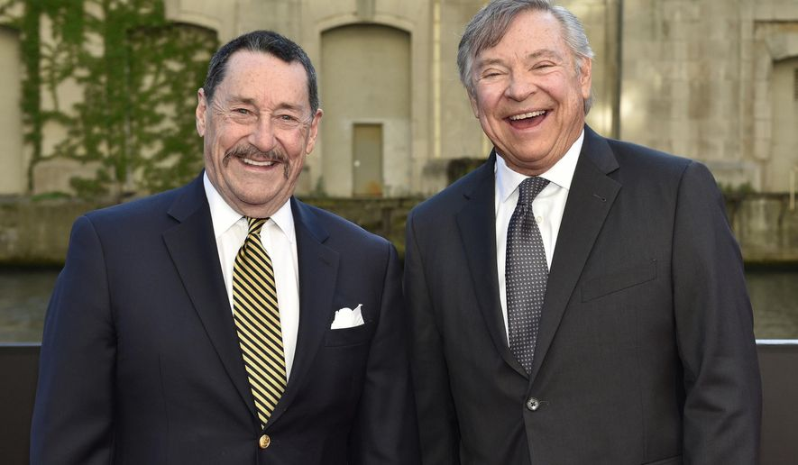 """FILE - In this Tuesday, June 20, 2017 file photo, Peter Cullen, left, and Frank Welker pose for a photo at the U.S. premiere of """"Transformers: The Last Knight"""" at the Civic Opera House in Chicago. Cullen and Welker could be heard in children's homes across the United States starting in the fall of 1984 as the heroic Optimus Prime and villainous Megatron respectively. (Photo by Rob Grabowski/Invision/AP, File)"""
