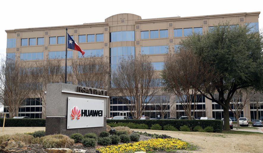 FILE - In this Thursday, March 7, 2019 file photo, the Texas state flag files outside the Huawei Technologies Ltd. business location in Plano, Texas. President Donald Trump issued an executive order Wednesday, May 15, 2019, apparently aimed at banning equipment from Chinese telecommunications giant Huawei from U.S. networks. It does not name specific countries or companies and gives the Department of Commerce 150 days to come up with regulations. (AP Photo/Tony Gutierrez, File)