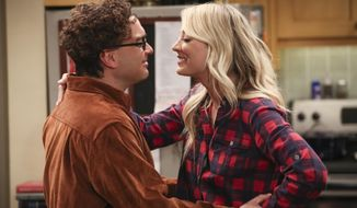 "This image released by CBS shows Johnny Galecki, left, and Kaley Cuoco in a scene from the series finale of ""The Big Bang Theory,"" airing Thursday on CBS. (Michael Yarish/CBS via AP)"