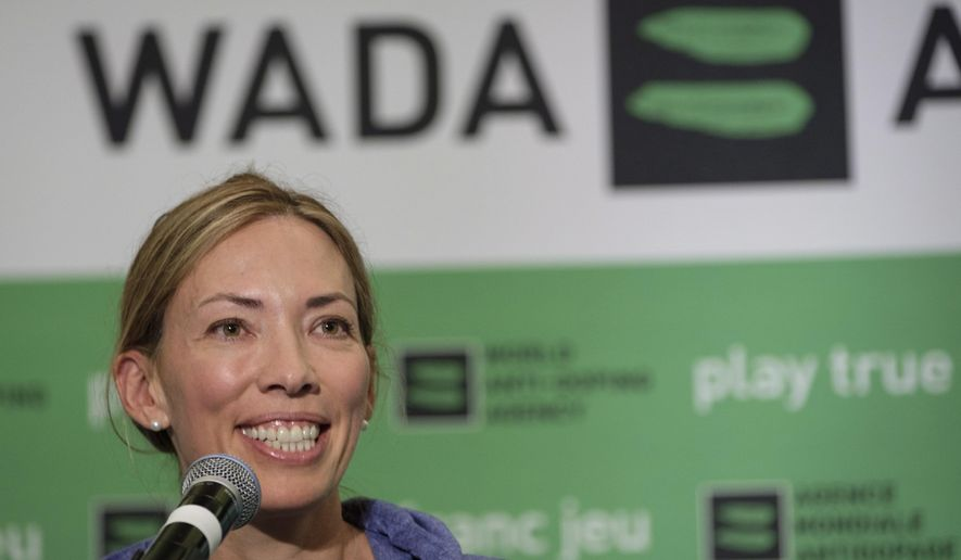 """FILE - In this June 5, 2018, file photo, Beckie Scott speaks at a news conference following the World Anti-Doping Agency's first Global Athlete Forum in Calgary, Alberta. A law firm found no evidence that WADA members bullied Scott, though it concluded that one member's comments to her """"could be viewed as aggressive, harsh or disrespectful."""" WADA released a 58-page report Wednesday night, May 15, 2019, that was conducted to determine whether Scott, the Canadian Olympic champion, was bullied at a contentious meeting last September when officials lifted the suspension of Russia's anti-doping agency over her protest. (Jeff McIntosh/The Canadian Press via AP, File)"""