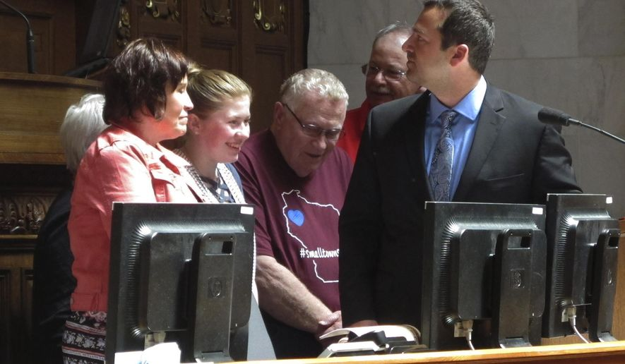 """Kidnapping victim Jayme Closs, second from left, appears with her family and supporters to receive a """"hometown hero"""" award from the Wisconsin Assembly on Wednesday, May 15, 2019, in Madison, Wis. Closs escaped in January after her parents were killed and she was held captive for three months in a remote cabin. (AP Photo/Scott Bauer)"""